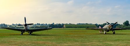 TELFORD, UK, JUNE 10, 2018 - A photograph documenting a Supermarine Spitfire with a Hawker Hurricane parked on the air strip at R royalty free stock photo