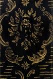 Telha decorativa preta com detalhes dourados Bandeiras pintadas bonitas do projeto da superfície Foto de Stock Royalty Free