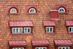 Telhado telhado com janelas do sótão Fotos de Stock