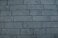 Telhas cinzentas do tijolo para pavimentar a textura imagens de stock