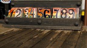 Telhas decorativas com dígitos Fotografia de Stock