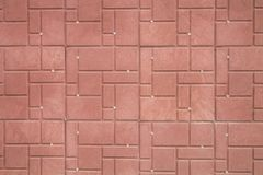 Telhas decorativas vermelhas na parede Imagens de Stock Royalty Free