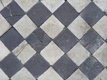 Telhas preto e branco velhas do bloco. Imagens de Stock Royalty Free