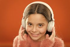 Free Tell Me What You Listen To, And I Will Tell You Who You Are. Girl Cute Little Child Wear Headphones Listen Music. Kid Stock Images - 158198474