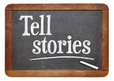 Tell stories advice on blackboard Stock Photo