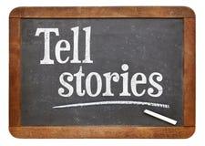 Tell stories advice on blackboard. Tell stories advice - text in white chalk on a vintage slate blackboard Stock Photo