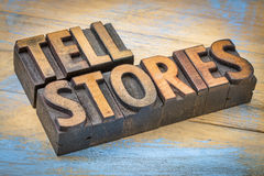Tell stories words in wood type. Tell stories word abstract - text in vintage letterpress wood type - storytelling concept Royalty Free Stock Images