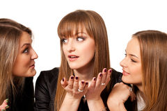 Tell tales. Three playmates share secrets isolated on white Stock Image