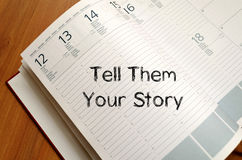 Tell them your story write on notebook. Tell them your story text concept write on notebook royalty free stock photography