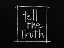 Tell the Truth. The phrase Tell The Truth written by hand in white chalk on a blackboard surface royalty free stock image