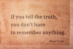 Tell the truth Twain. If you tell the truth, you don`t have to remember anything - famous American writer Mark Twain quote printed on vintage grunge paper Royalty Free Stock Photo