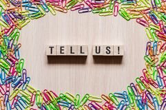 Tell us words concept stock image