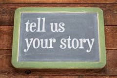 Tell us your story - text on slate blackboard Royalty Free Stock Image