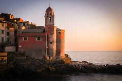 Tellaro church at sunset. A beautiful ancient church peacefully facing the sea in Tellaro, Liguria, Italy Stock Photos