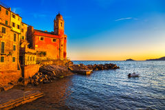 Tellaro rocks, church and village on sunset. Cinque terre, Ligur Stock Photography