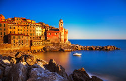 Tellaro rocks, church and village on sunset. Cinque terre, Ligur Royalty Free Stock Photos