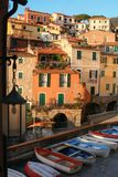 Tellaro village at sunset. Small boats in the beautiful village of Tellaro, Italy, near Cinque Terre with the tipical colourful houses of Liguria Stock Images