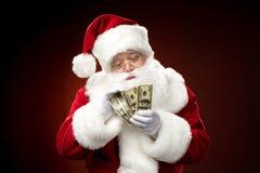 Tellende de dollarbankbiljetten van Santa Claus Royalty-vrije Stock Foto's