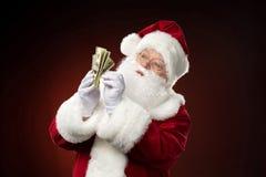 Tellende de dollarbankbiljetten van Santa Claus Royalty-vrije Stock Foto