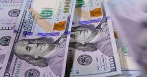 Tellende Dollarbankbiljetten stock footage
