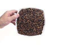 Teller voll der Kaffeestartwerte für zufallsgenerator Lizenzfreie Stockfotografie