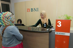 Teller. Was serving customers at a bank in the city of Solo, Central Java, Indonesia Royalty Free Stock Photos