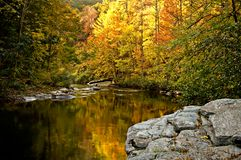 A river winds through the bright colors of autumn. stock photography