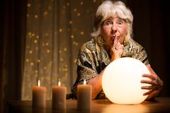 Telling fortune from magic ball Royalty Free Stock Photos