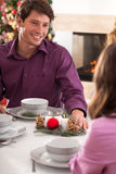 Telling a joke during christmas eve Stock Images