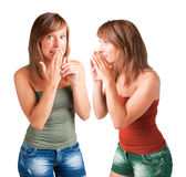 Telling a Secret. Woman talking and another woman listening Royalty Free Stock Photography