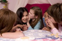 Telling Secrets. At a slumber party stock photo