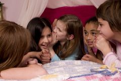 Telling Secrets. At a slumber party Stock Photos