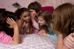 Telling Secrets. At a slumber party royalty free stock image