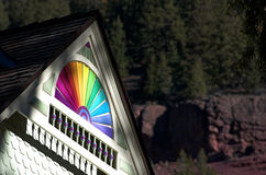 Telluride house detail. Rainbow pattern painted detail in the peak of the roof of restored victorian house in telluride colorado Royalty Free Stock Photos