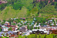 Telluride town surrounded by mountain hillsides, Colorado. Stock Photo