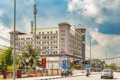 Hotel building in Teluk Intan, Malaysia. Teluk Intan, Malaysia - December 12, 2017: Traffic on the road in front of the hotel building in Teluk Intan, Malaysia royalty free stock image