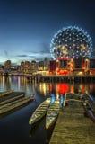 TELUS WORLD OF SCIENCE - False Creek, Vancouver. The Telus World Of Science lights up at night reflecting onto False Creek Royalty Free Stock Photo
