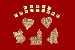 Tema de la Navidad con deseos en fondo rojo Imagen de archivo libre de regalías