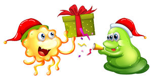 Tema de la Navidad con los monstruos y el presente Imágenes de archivo libres de regalías