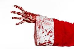Tema de la Navidad y de Halloween: Mano sangrienta de Santa Zombie en un fondo blanco Imagen de archivo