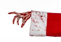Tema de la Navidad y de Halloween: Mano sangrienta de Santa Zombie en un fondo blanco Fotografía de archivo