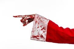 Tema de la Navidad y de Halloween: Mano sangrienta de Santa Zombie en un fondo blanco Fotos de archivo