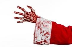 Tema de la Navidad y de Halloween: Mano sangrienta de Santa Zombie en un fondo blanco Foto de archivo libre de regalías