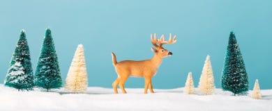 Tema del día de fiesta de la Navidad con el reno Fotos de archivo