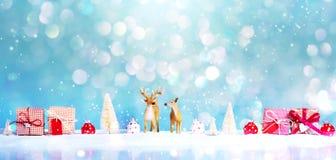 Tema del día de fiesta de la Navidad con el reno Fotografía de archivo