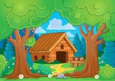 Tema del árbol con el edificio de madera Foto de archivo libre de regalías
