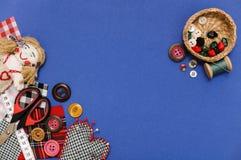 Tema di cucito sul blu Fotografia Stock Libera da Diritti