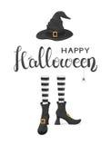 Tema di Halloween con le gambe delle streghe in scarpe e cappello Fotografia Stock