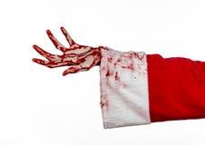 Tema di Halloween e di Natale: Mano sanguinosa di Santa Zombie su un fondo bianco Immagini Stock Libere da Diritti