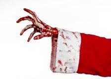 Tema di Halloween e di Natale: Mano sanguinosa di Santa Zombie su un fondo bianco Fotografia Stock